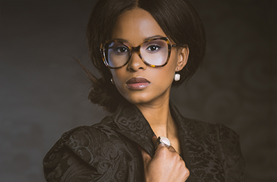A beautiful black woman wearing glasses